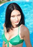 Girl in bikini at poolside Stock Photo