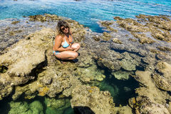 Girl in bikini posing on a coral reef in the Red Sea Stock Photos