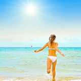 Girl in bikini running Stock Photography