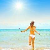 Girl in bikini running stock photography