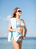 Girl in bikini and shades on the beach Royalty Free Stock Image