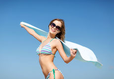 Girl in bikini and shades on the beach Stock Photography