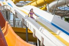 Girl in bikini sliding water park Royalty Free Stock Photos