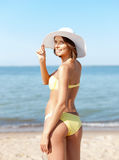 Girl in bikini standing on the beach Royalty Free Stock Images