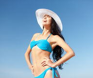 Girl in bikini standing on the beach Royalty Free Stock Photo