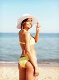Girl in bikini standing on the beach Royalty Free Stock Photos