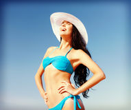 Girl in bikini standing on the beach Royalty Free Stock Photography