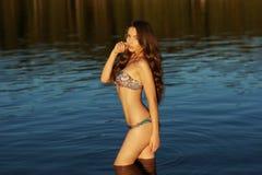 Girl in bikini standing in water Royalty Free Stock Photo