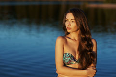 Girl in bikini standing in water Stock Images