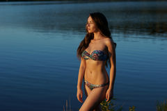 Girl in bikini standing in water Royalty Free Stock Photos