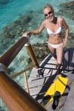 Girl in bikini on steps - French Polynesia stock photography