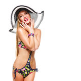 Girl in bikini and summer hat Royalty Free Stock Photography