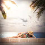 Girl in bikini sunbathes Stock Photography