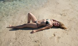 Girl in bikini sunbathing  at  beach Royalty Free Stock Photos