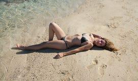 Girl in bikini sunbathing  at  beach Royalty Free Stock Photos