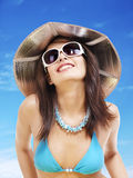 Girl in bikini and sunglasses on beach. Stock Photography