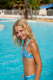 Girl in bikini by swim pool Royalty Free Stock Images