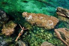 Girl in bikini swimming in the sea aerial top view Stock Photography