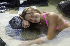 Girl in bikini in a tide pool Stock Photography