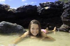 Girl in bikini in a tide pool Royalty Free Stock Photo