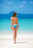 Girl in bikini on the tropical beach Stock Photo