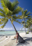 Girl in bikini under a palm tree - Polynesia Stock Photo