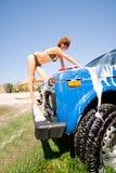 Girl in bikini washing car with selective focus Royalty Free Stock Photography