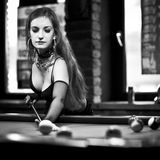 Girl on billard table Royalty Free Stock Image