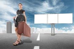 Girl and billboard Stock Image