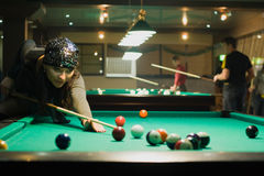 Girl in billiard Stock Photography