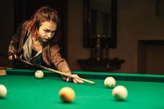 Girl in the billiard room stock images