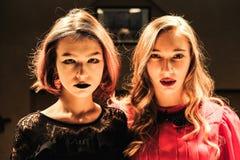 Girl in the billiard room. Two beautiful girls in the billiard room Stock Photo