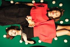 Girl in the billiard room. Two beautiful girls in the billiard room Royalty Free Stock Image
