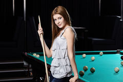 The girl at a billiard table Stock Photos