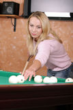 Girl at billiards table Royalty Free Stock Photos