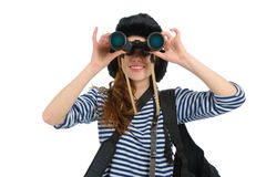 Girl with binocular. Traveller young girl dressed in sailor's with binocular on white background stock photography
