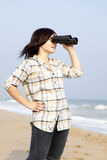 Girl with binocular Royalty Free Stock Image