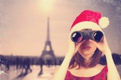 Girl with binocular Stock Images
