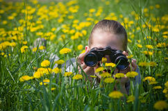 Girl with binocular Royalty Free Stock Images