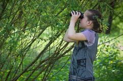 Girl binocular outdoor Royalty Free Stock Photos