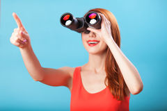 Girl with binocular Royalty Free Stock Photography