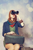 Girl with binocular Stock Photo