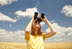 Girl with binocular watching in sky. Stock Photos