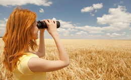 Girl with binocular watching in sky. Stock Photo