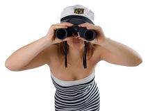 Girl with binoculars. Girl looking at you through binoculars isolated on a white background Stock Image