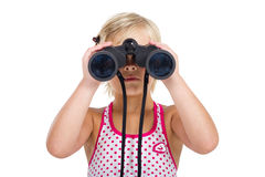 Girl with binoculars Royalty Free Stock Image
