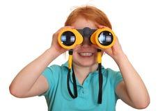 Girl with binoculars Royalty Free Stock Photo