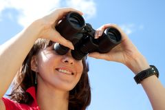 Girl with binoculars Stock Image