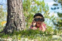 Girl with binoculars Royalty Free Stock Photos