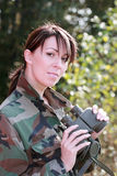 Girl with a binoculars. The attractive girl in a camouflage with a binoculars Royalty Free Stock Photography